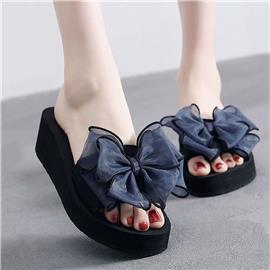 Met strik versierde open teen slippers