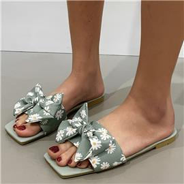 Sandalen met bloemmotief en strikversiering