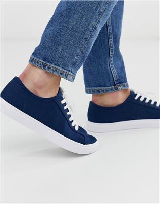 ASOS DESIGN - Sneakers in marineblauw canvas