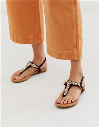 Buffalo - Platte sandalen met glittersteentjes in zwart
