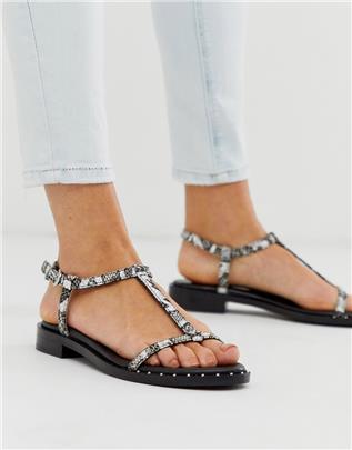 Bronx - Leren sandalen met bandjes in zwart en wit met slangenprint
