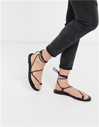 ASOS DESIGN - Forest - Minimalistische sandalen met teenlus in zwart