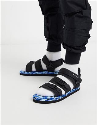 ASOS Unrvlld Spply - Tech sandalen in zwart met felgekleurde zool