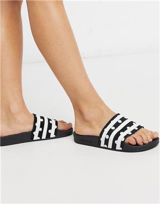 adidas Originals - Adilette - Gestipte slippers in zwart