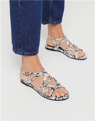 XTI - Platte sandalen met bandjes en slangenprint-Grijs