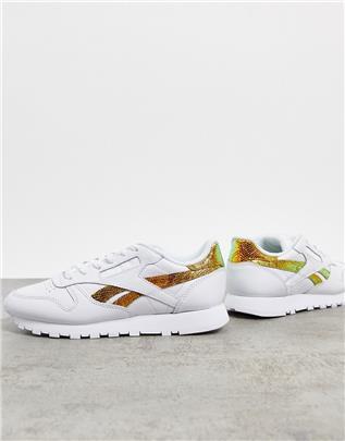 Reebok - Classic - Leren sneakers in wit met gouden slangenleerprint
