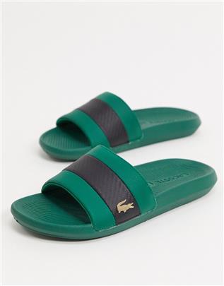 Lacoste - Slippers met gouden krokodil in groen