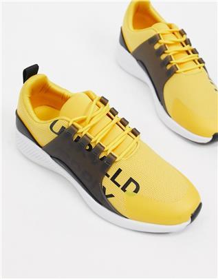 Asos - Unrvlld Spply - Hardloopschoenen met logo en rubberen paneel-Geel